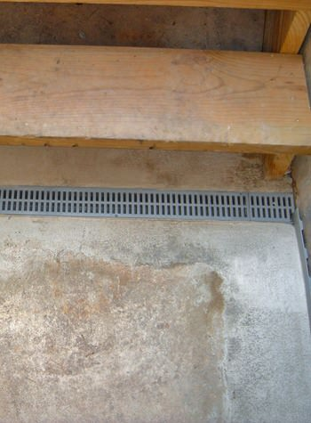 grated basement drain system for the end of stair cases that leak