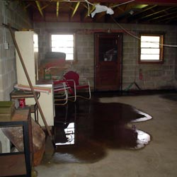 A flooded basement showing groundwater intrusion in Quincy