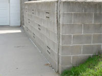 A retaining wall separating from the adjoining walls in Bellflower