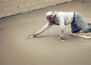 smoothing out the grout in a slab releveling project in Palmyra