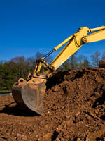 A backhoe excavating a foundation