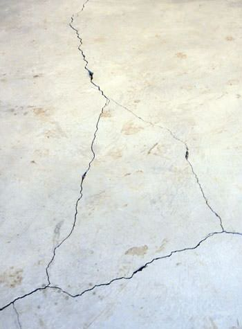 severely cracked, heaving slab floors in a home in Liberty