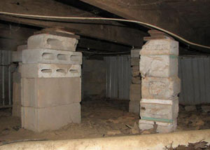 crawl space repairs done with concrete cinder blocks and wood shims in a Colchester home