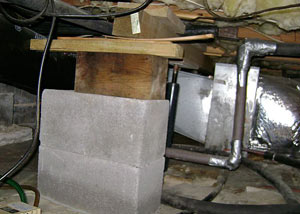 a poorly designed crawl space support system installed in a Mason City home