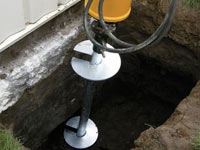 Installing a helical pier system in the earth around a foundation in Fort Madison