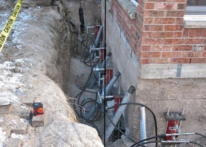 Foundation push piers installed around a house with a foundation settlement issues in Edina