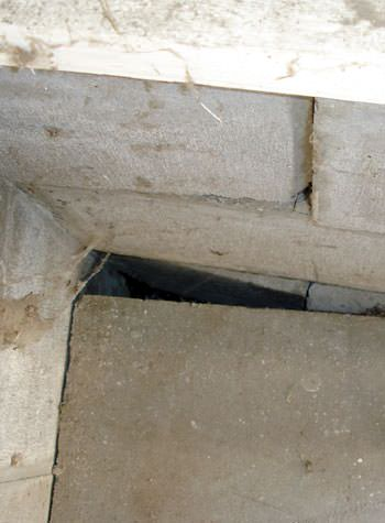 inward rotation of a foundation wall damaged by street creep in a garage in Elliott