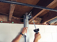 Straightening a foundation wall with the PowerBrace™ i-beam system in a West Burlington home.