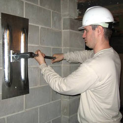 installing a wall anchor to repair an bowing foundation wall in West Burlington
