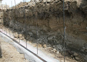 Soil layers exposed while excavating to construct a new foundation in Carthage