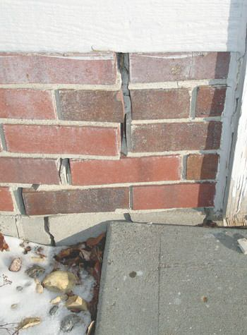 Severe street creep damage to a garage wall outside a La Harpe home
