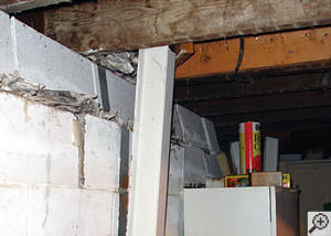 A failing foundation wall and i-beam support in a Quincy home