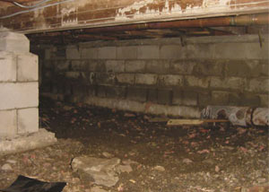 Rotting, decaying crawl space wood damaged over time in Liberty