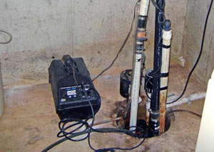 Pedestal sump pump system installed in a home in Mason City