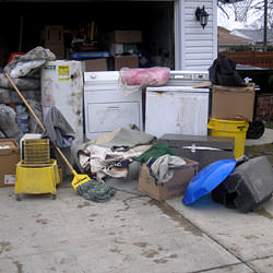 Soaked, wet personal items sitting in a driveway, including a washer and dryer in Palmyra.
