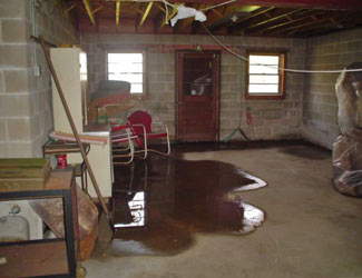 a flooded basement floor in a Astoria home