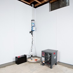 Sump pump system, dehumidifier, and basement wall panels installed during a sump pump installation in Hamilton