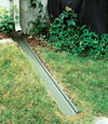A recessed gutter drain extension installed in Astoria, Illinois, Iowa, and Missouri